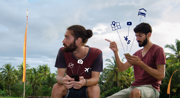 Mario and Nuno in a rice field using the travel apps on their smartphones