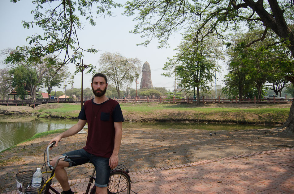 Mario on a bycicle near a temple in Ayutthaya