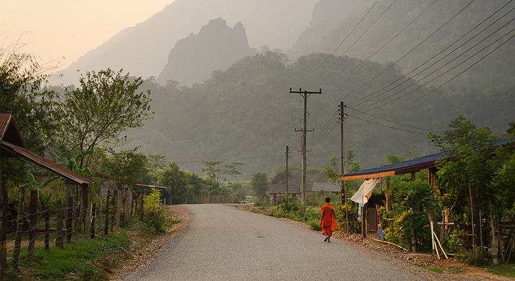 Monk walking alone in Laos