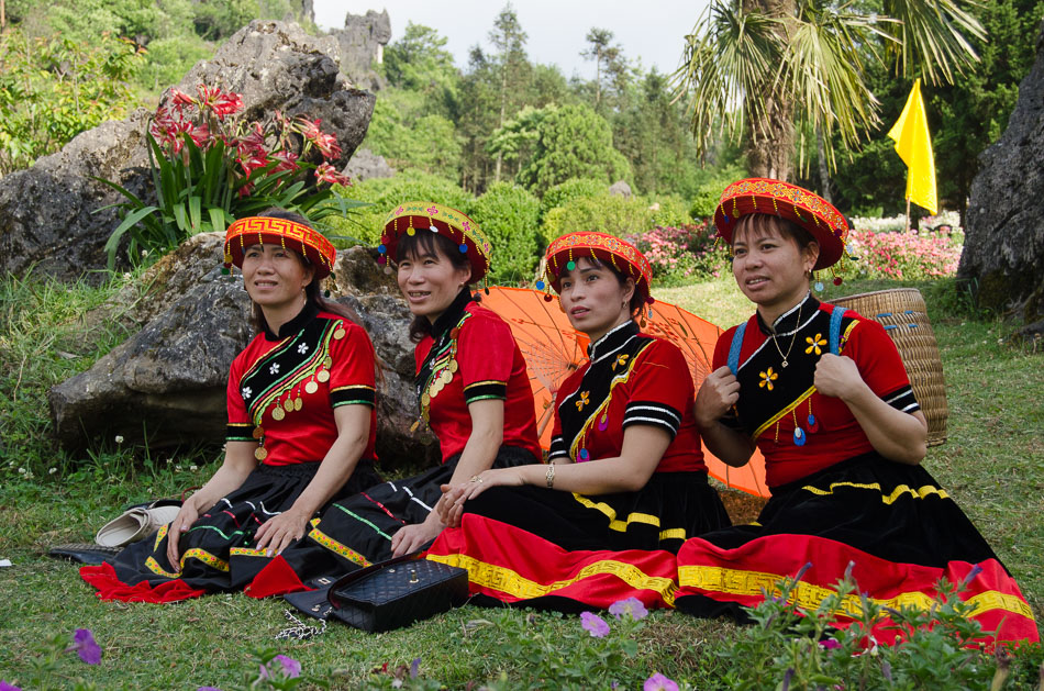 4 women in traditional costumes